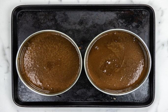 Pour batter into two pans