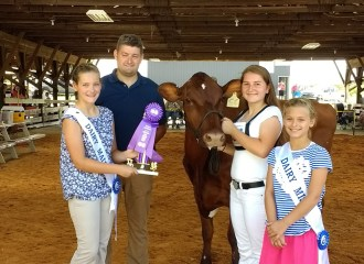 Vannika and Holly recieving Grand Champion