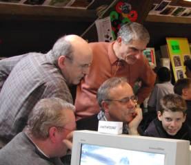 Grande discussion devant un PC