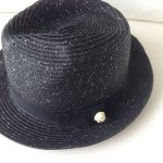 black hat with camelia