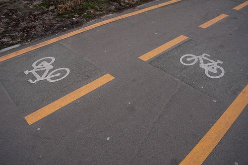 Two urban cycling lanes on the pavement