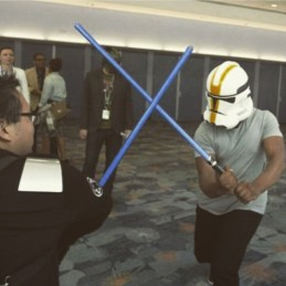 "john_boyega: ""Lightsaber fight with SW fan at convention...blending in nicely."""