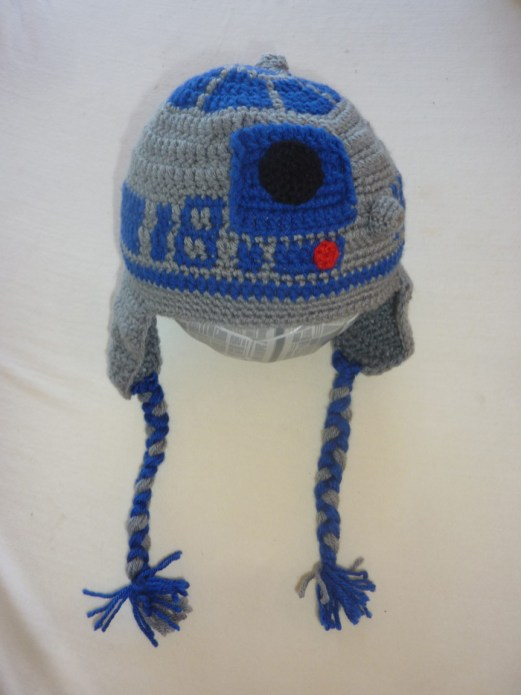 Hand-crocheted R2-D2 beanie with tasseled ear flaps