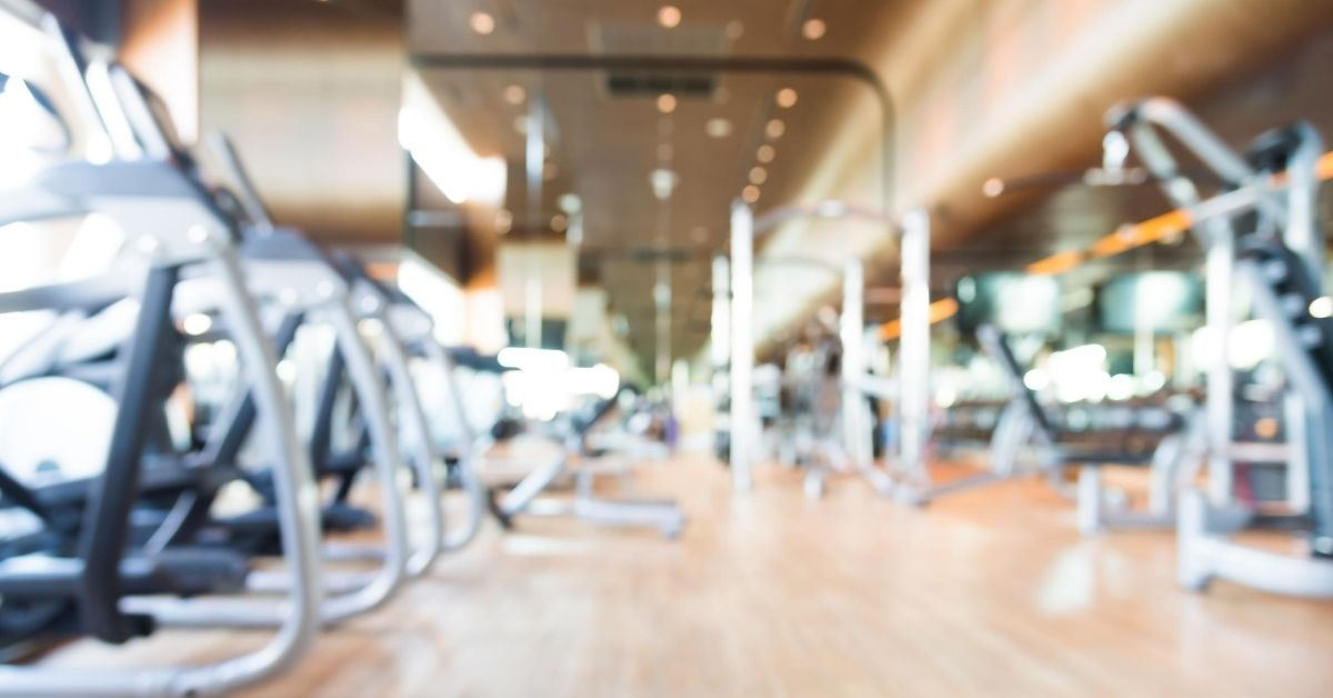 My Biggest Financial Regrets - blurred out picture of a membership gym room