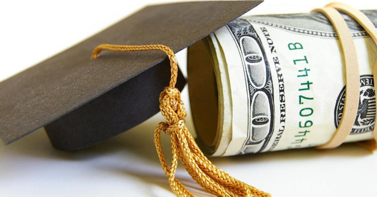 Student Loan Debt Forgiveness A Rant - picture of roll of hundred dollar bills with graduation cap