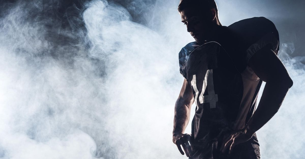 Professional Sports The Opiate of the Masses - picture of silhouetted football player