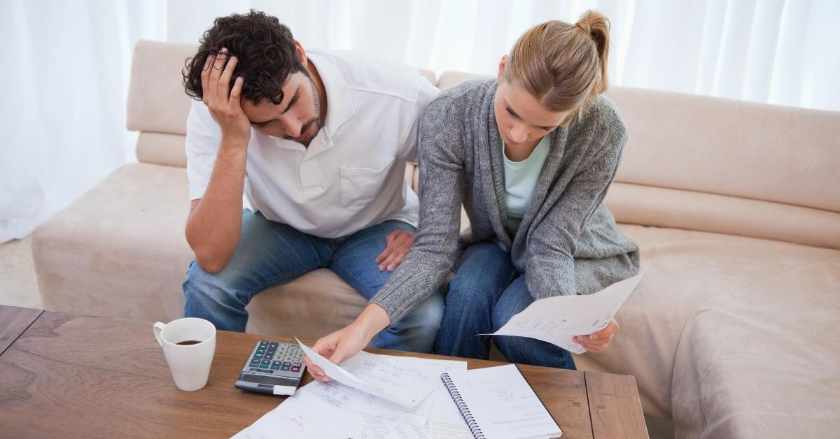 The Amazing Power of Debt - picture of couple stressed about bills
