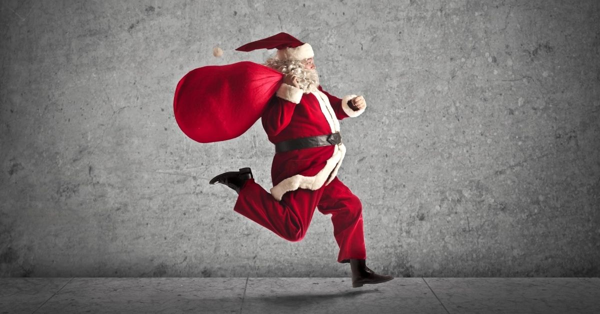 Confessions of a Cheap-Ass Santa - picture of Santa running holding bag over shoulder
