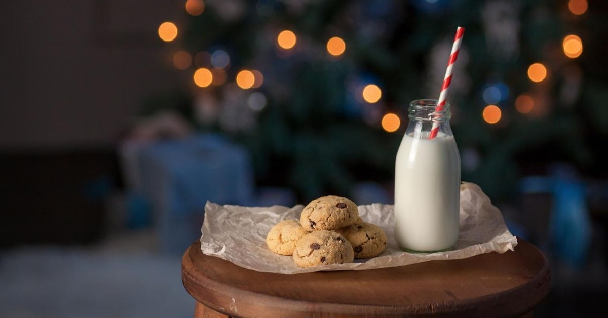 My Favorite Christmas Memories - picture of glass of milk and cookies in front of Christmas tree