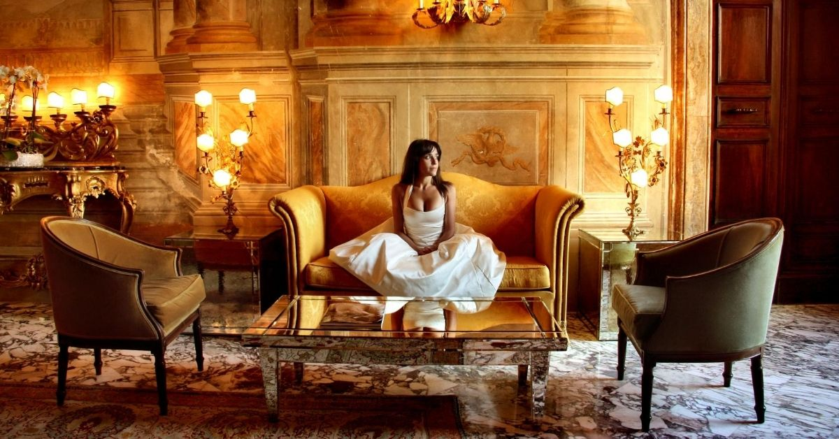 The Queen of Versailles - picture of woman sitting in luxurious room