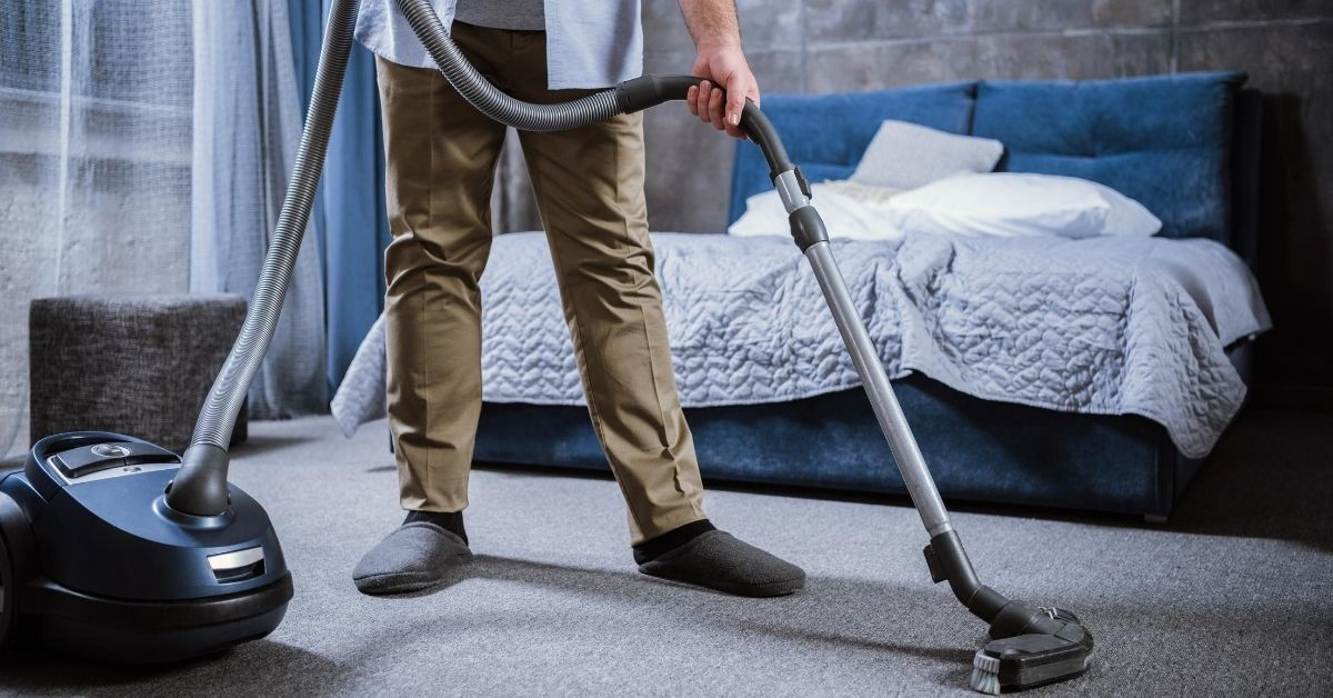 4 Frugal and Clutter-Free Mother's Day Gift Ideas - picture of man vacuuming
