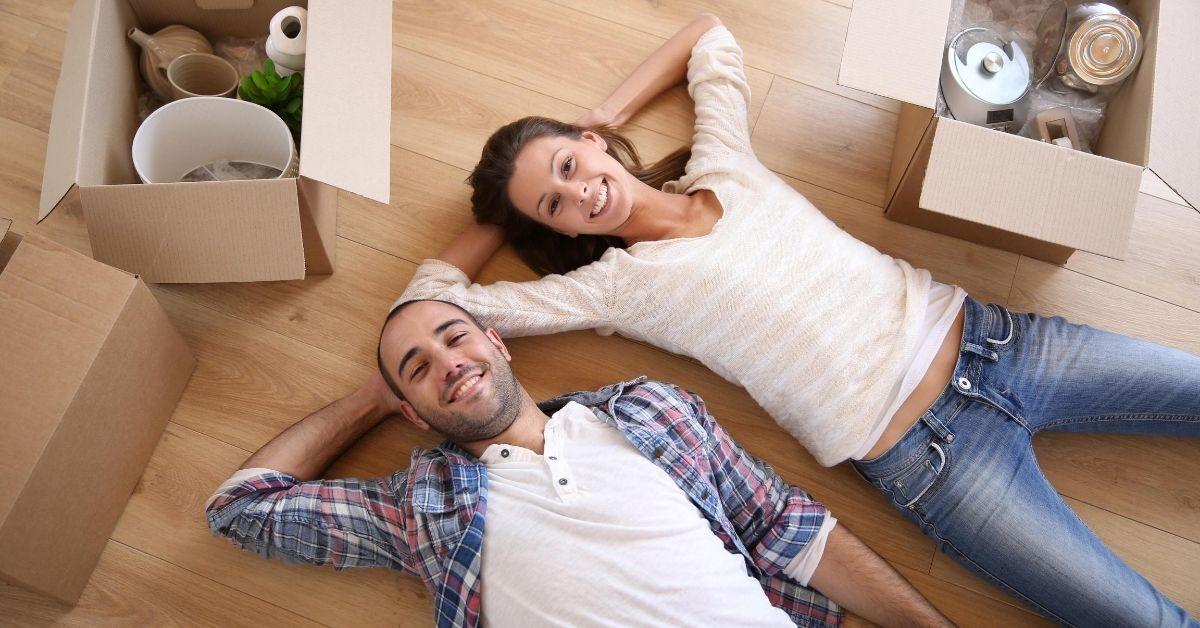 Doing Your Homework - picture of young couple laying on floor of new home