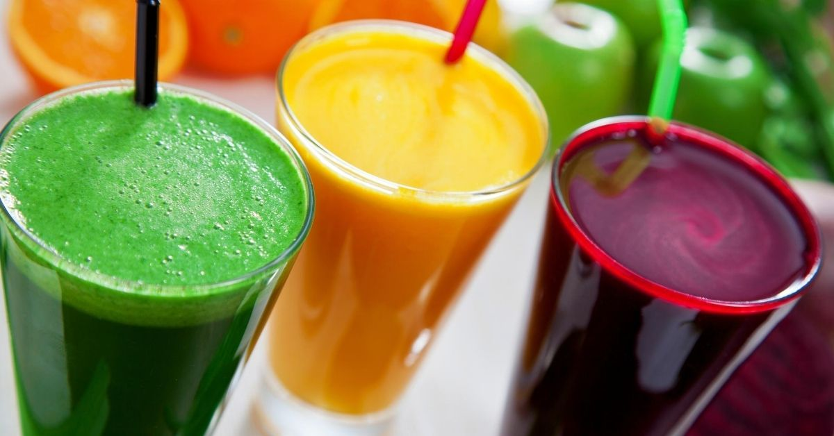 Benefits of Juicing - picture of three glasses of differently colored juices