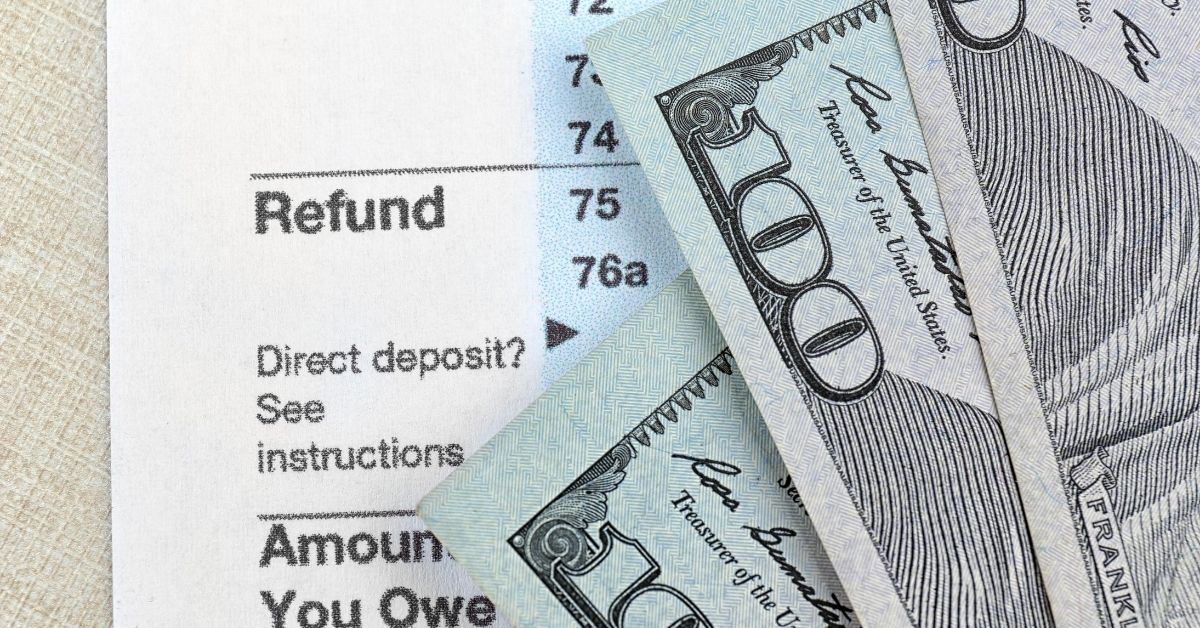 Five Constructive Ways to Spend Your Tax Refund - picture of tax form with money laying on it