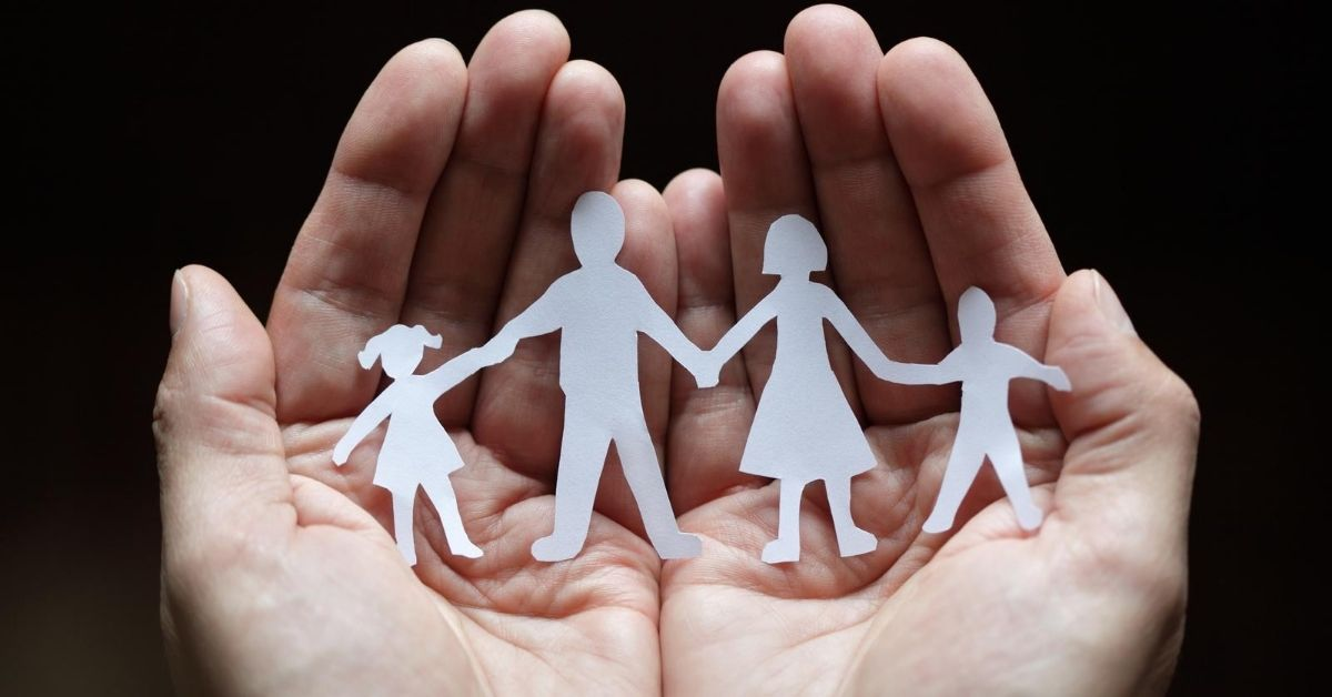 Life Insurance What Would Happen if You Died - picture of family cutout cupped in someone's hands