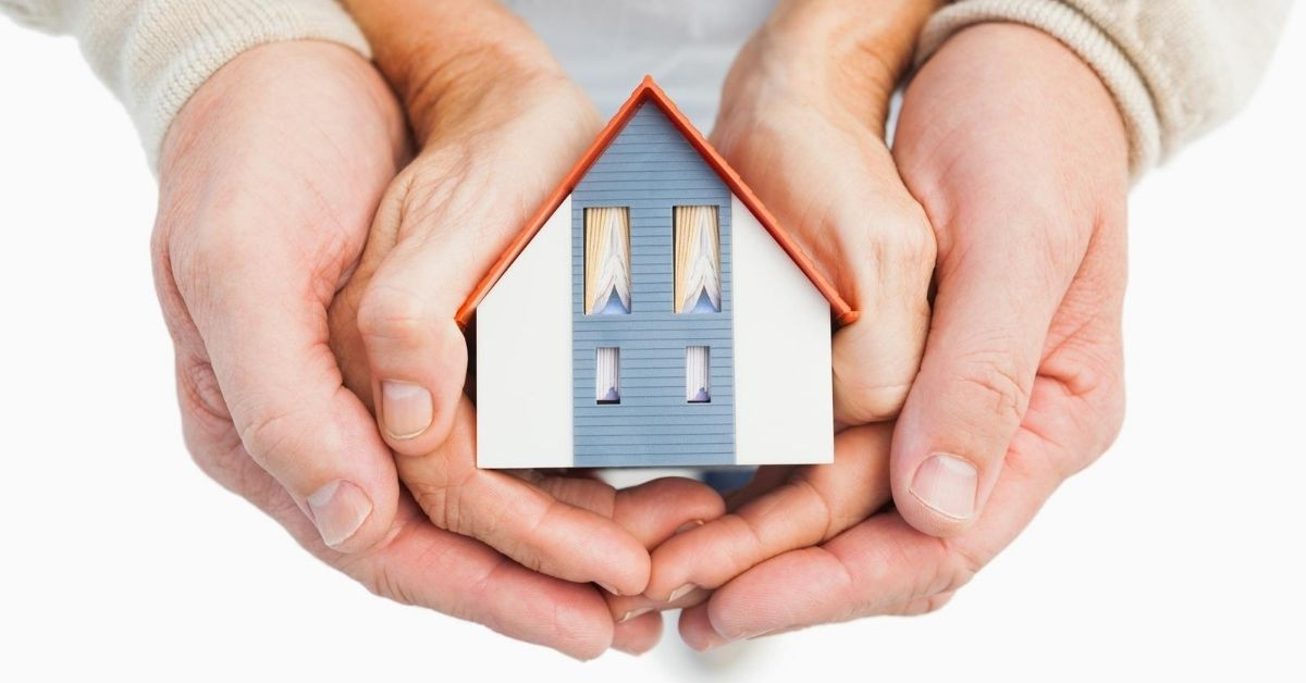 The Most Commonly Asked Credit Score Questions - picture of two pairs of hands holding model house