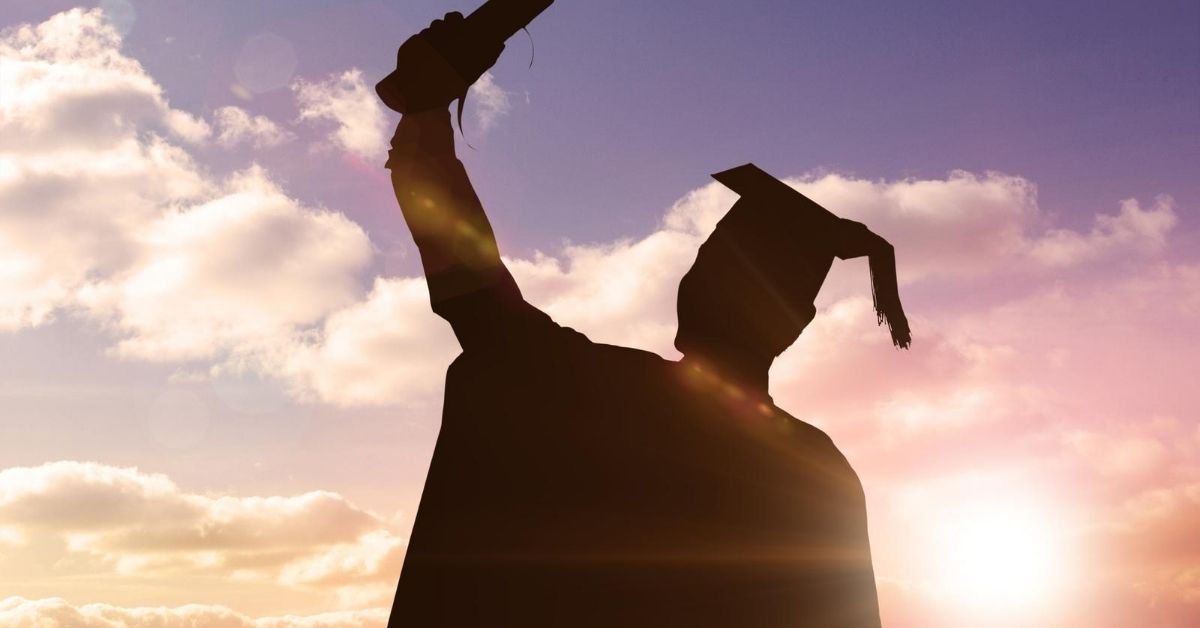 Life After College - picture of silhouetted graduate raising diploma in air