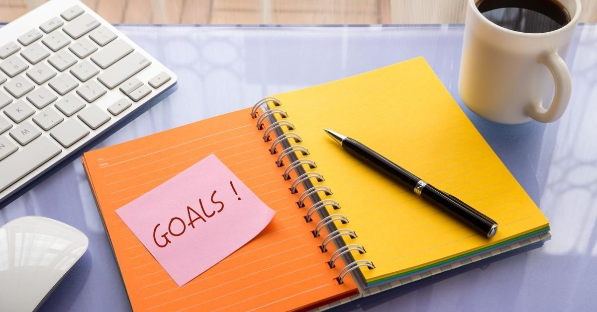 Cash Money $7,230 in June Income Blog Updates and Goals - picture of sticky note with Goals written on it attached to notebook with coffee and keyboard