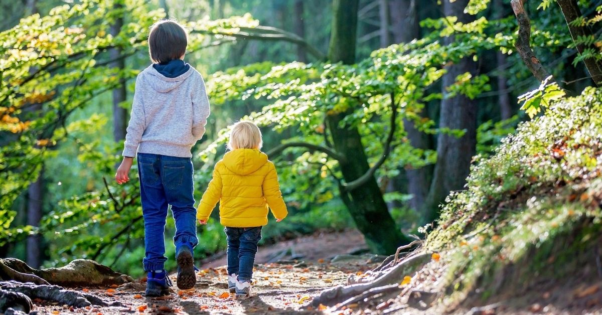 Club Thrifty Fall Financial Lockdown - picture of two kids walking on trail