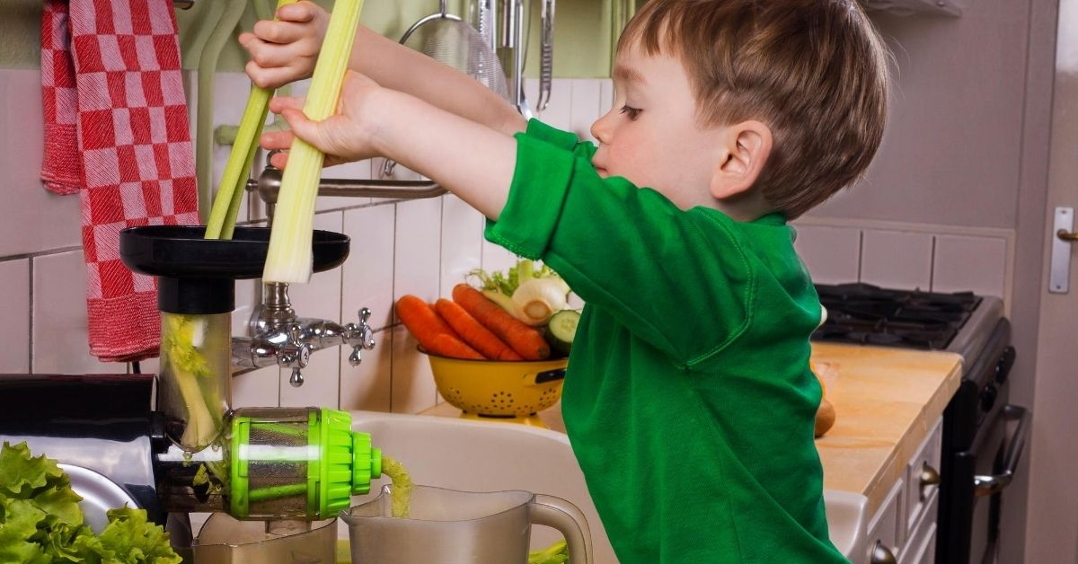 Juicing Recipes - picture of little boy making green juice