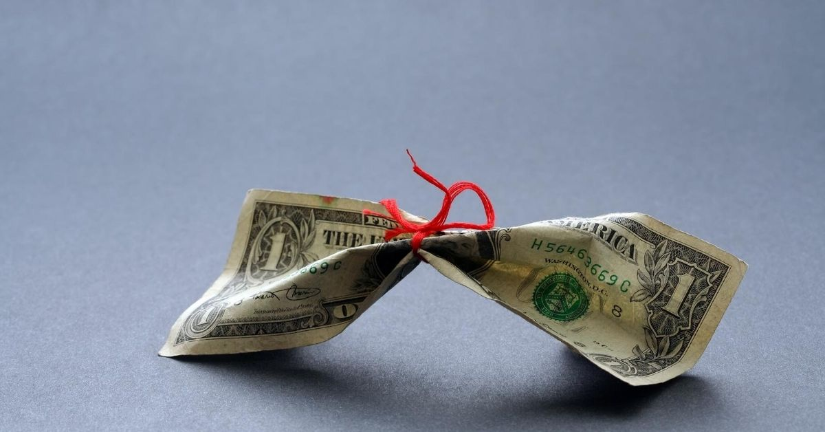 It's Friday This Week's Frugal Moves - picture of dollar bill with string tied around it
