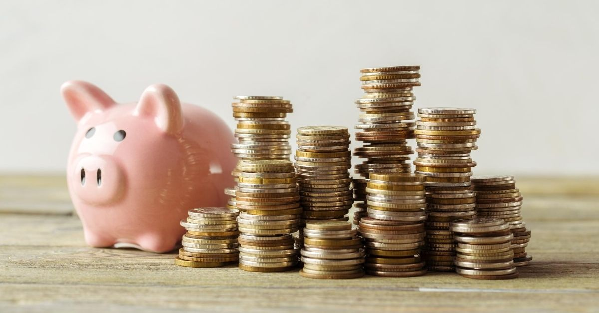 6 Unexpected Ways to Save - picture of piggy bank next to stacks of coins