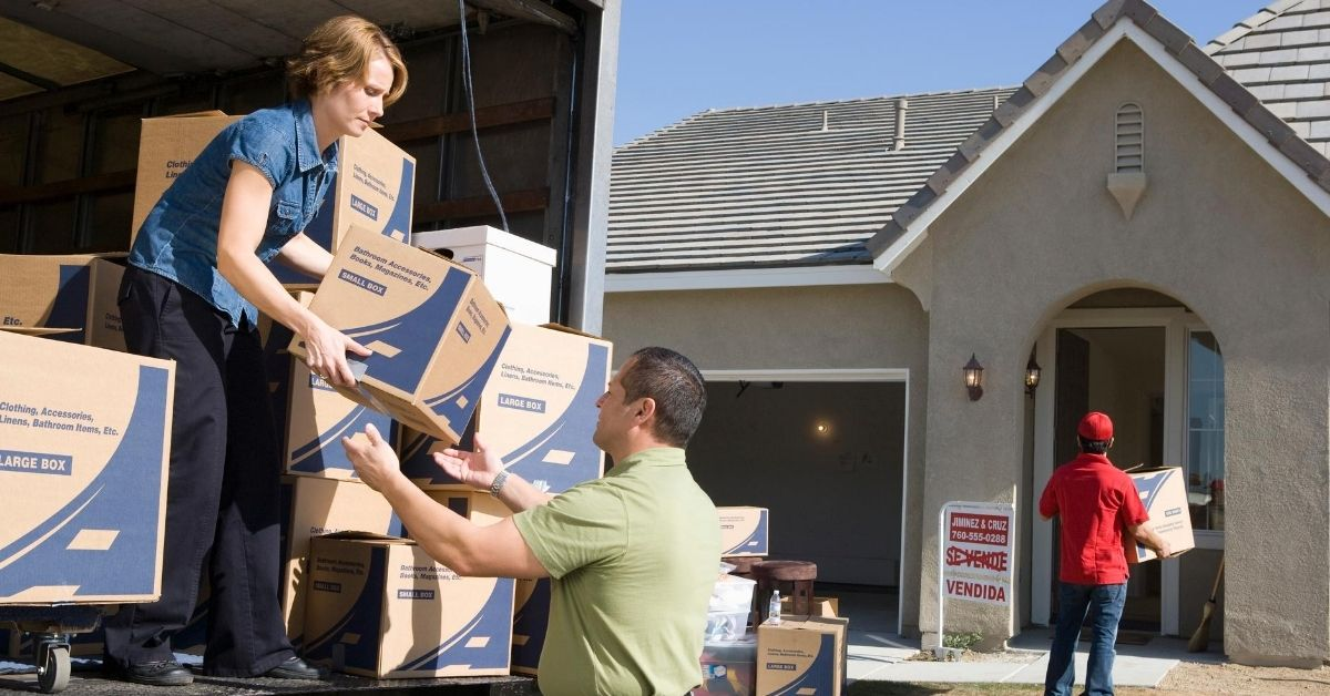 All My Sons Moving in Indianapolis BEWARE - picture of couple moving boxes out of moving truck