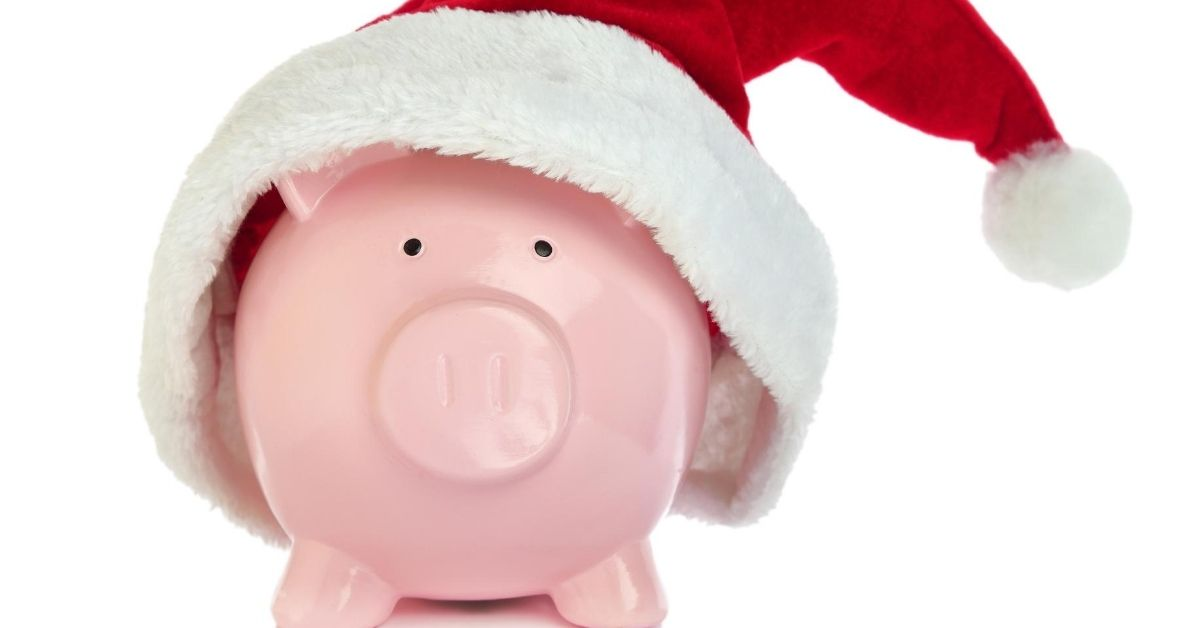 More Confessions From a Cheap-Ass Santa - picture of piggy bank with santa hat on