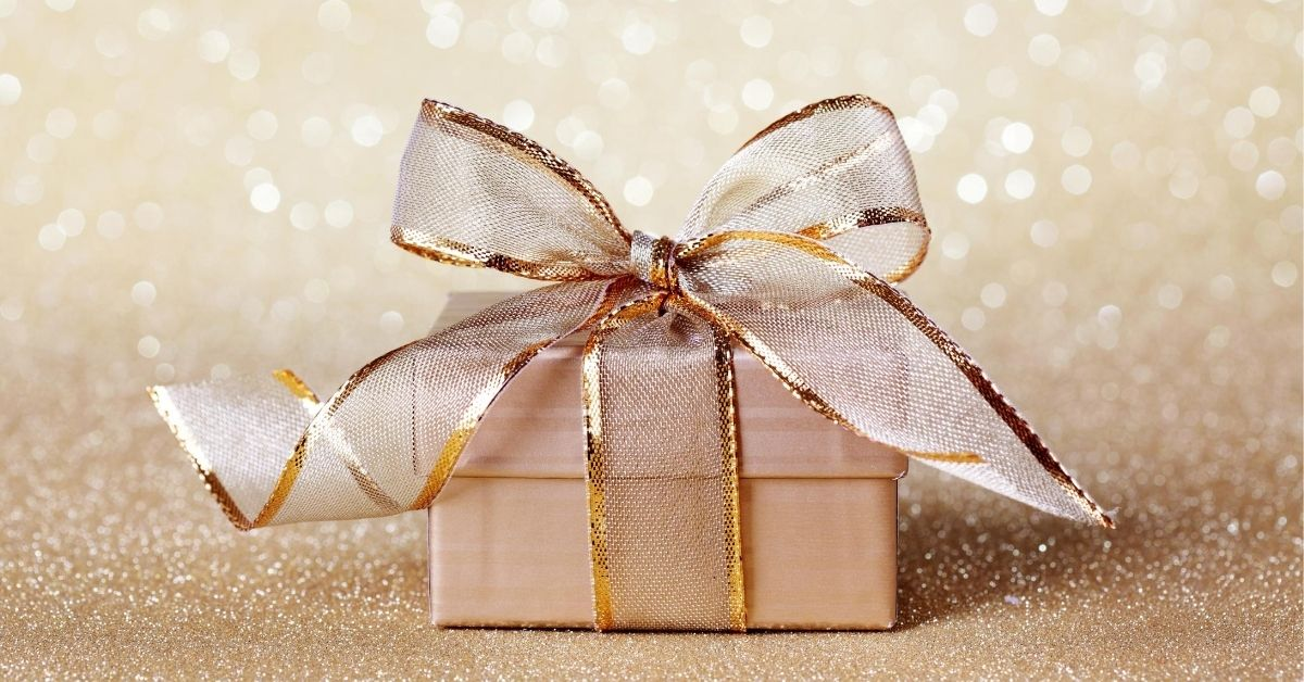 December Budget Breakdown - picture of light gold gift box with glittery light gold background