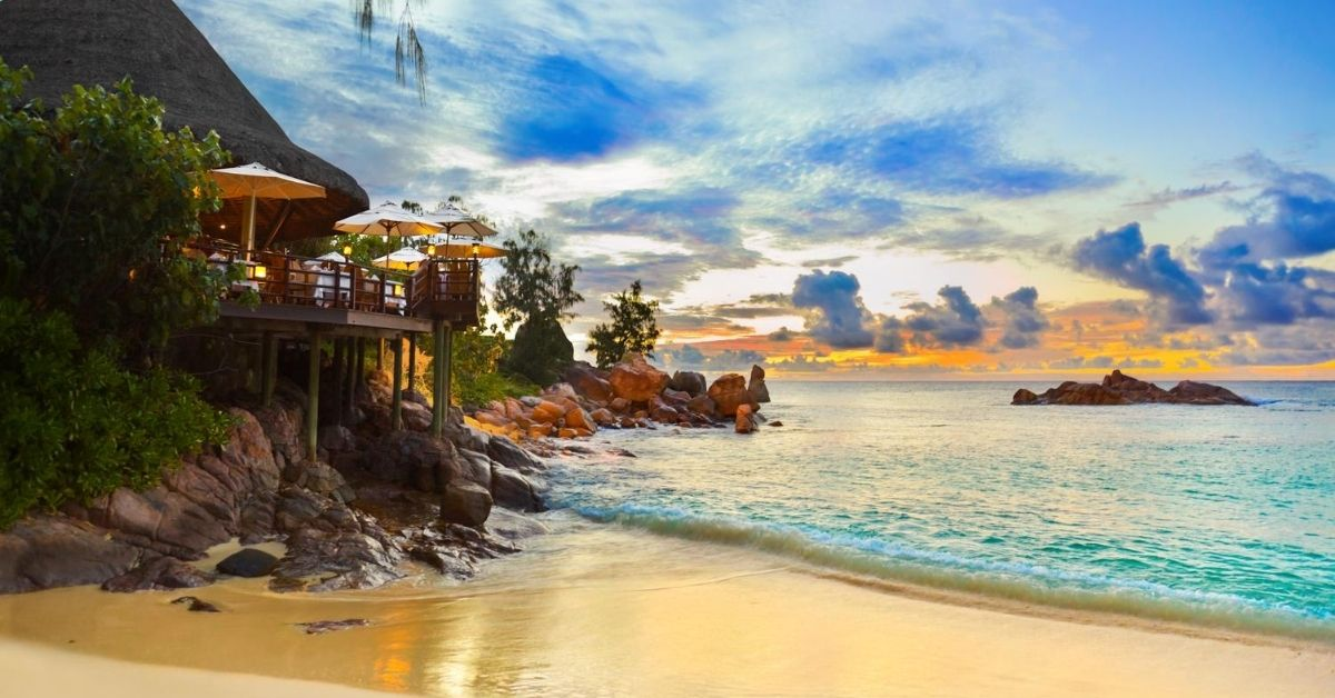 Squashing Vacation Envy - picture of cafe at tropical island beach at sunset