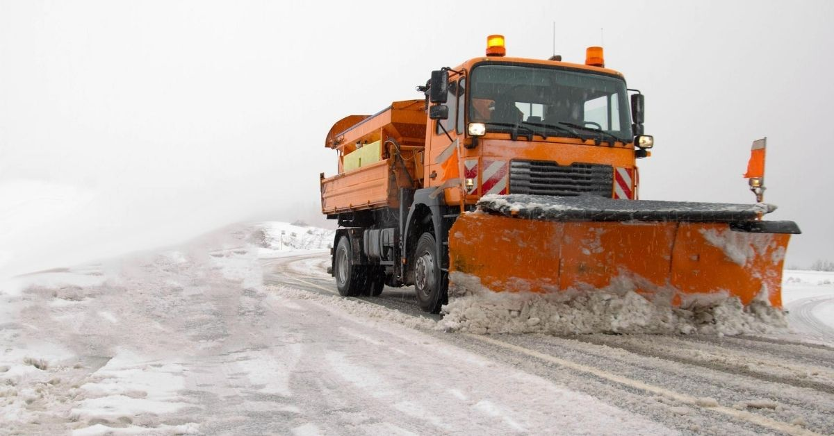 How Snowpocalypse Cost Us Almost $1,500 - picture of orange truck plowing snow from road