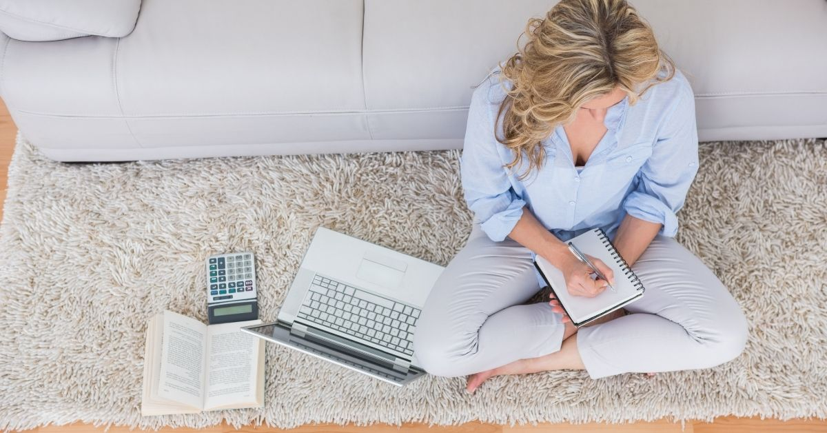 Cash Money $5,565 in February Income Plus Blog Updates - top view picture of woman sitting on floor working