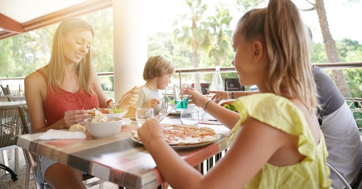 Restaurant Dining - picture of family eating at outdoor restaurant