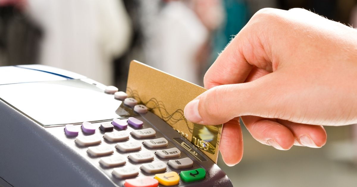 How Small Business Saturday Made Me Feel Like a Jerk - picture of hand sliding credit card through payment machine