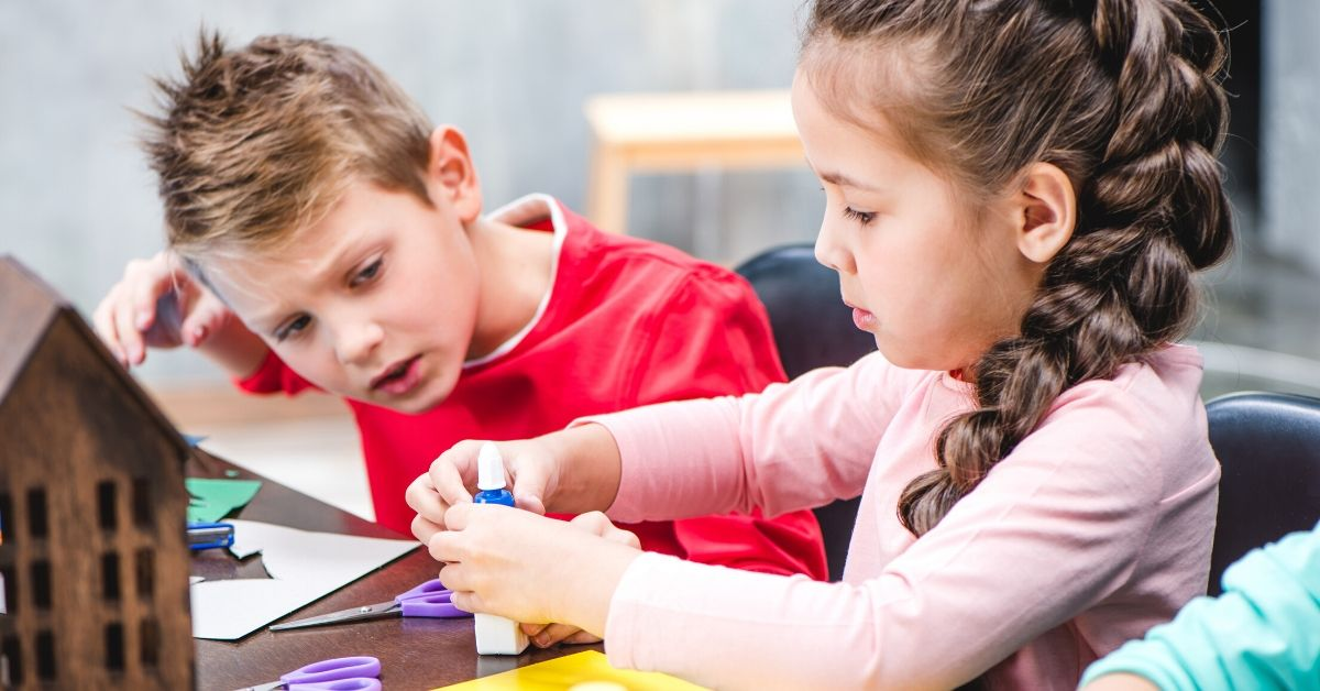 The Benefits of Year-Round School - picture of boy and girl doing arts and crafts