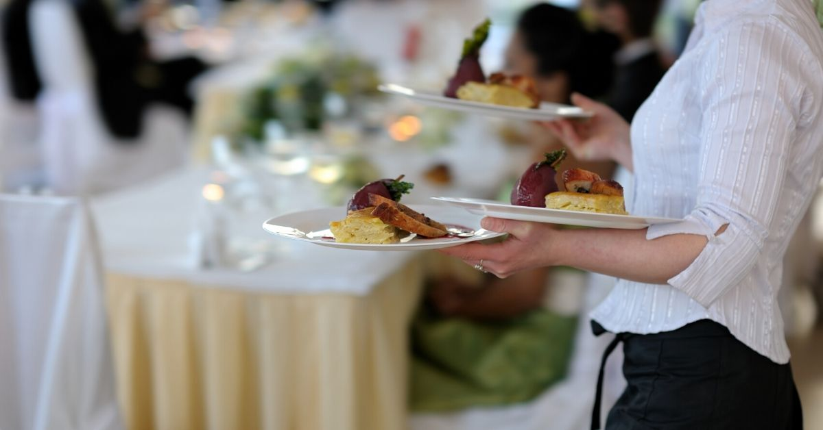 What to Do if You Are Morally Opposed to Tipping Servers - picture of server with three plates of food in hands