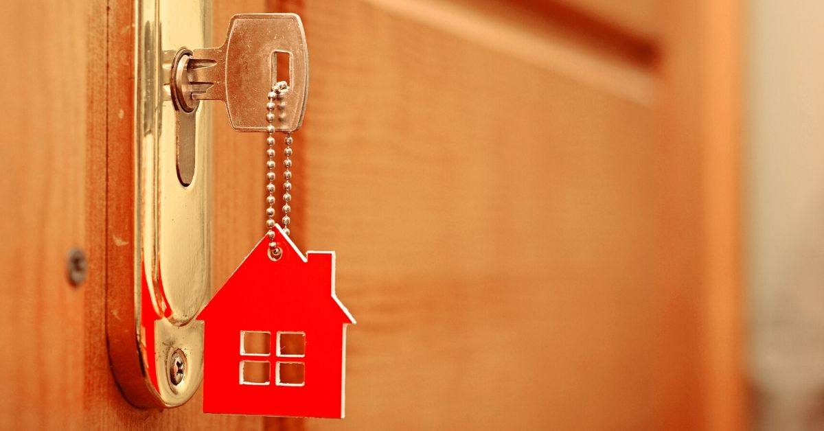 Confessions of a Landlord I Never Raise the Rent - picture of key in doorknob with little red house hanging down