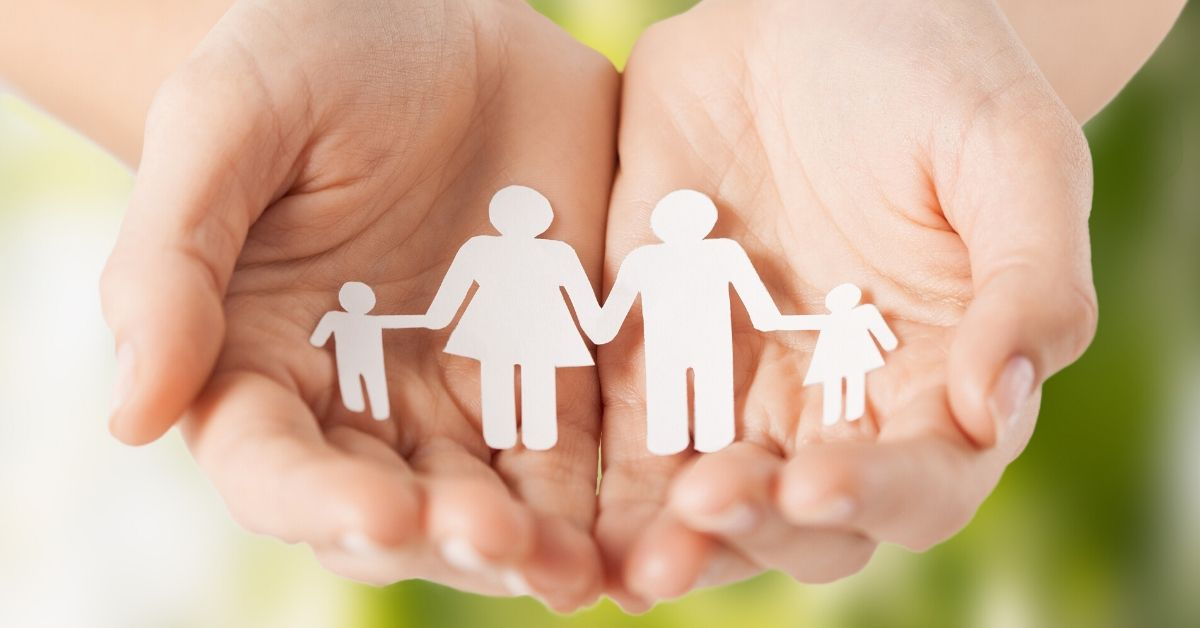 Preparing for an Unlikely Death - picture of cut-out of family held in outstretched hands