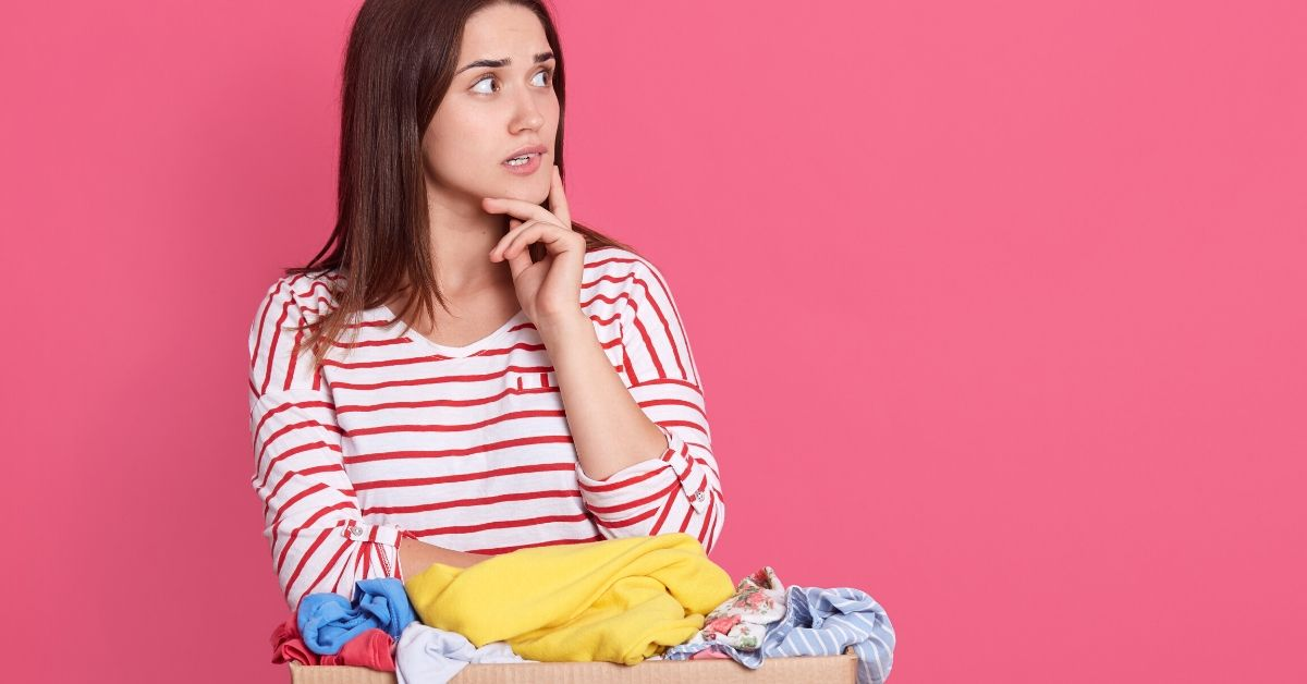 Should Rich People Take Free Stuff - picture of woman looking concerned with box of clothes