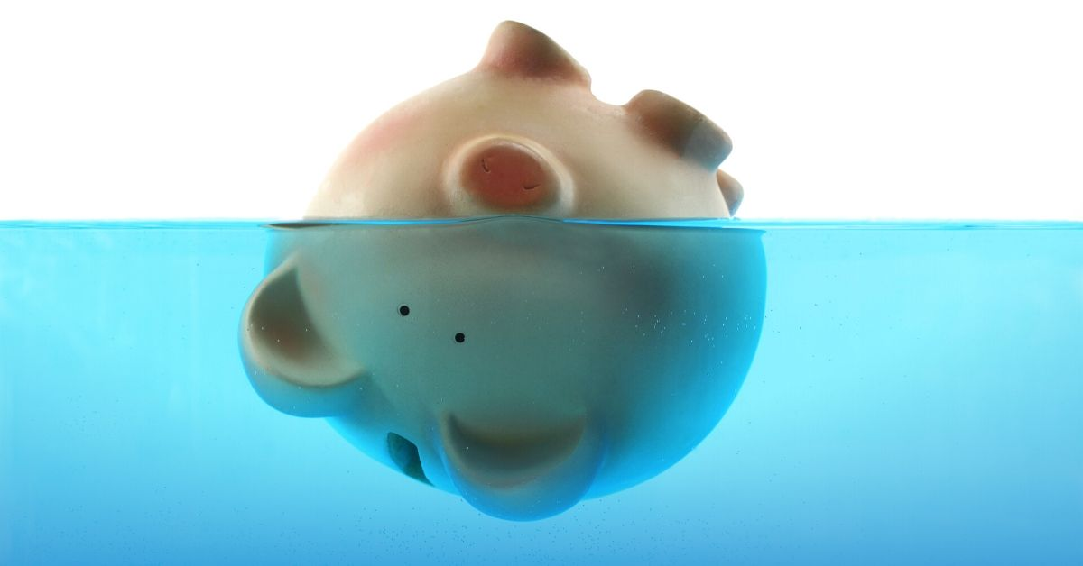 Epic Budget Failure When Everything Goes Wrong - picture of piggy bank upside down floating in water