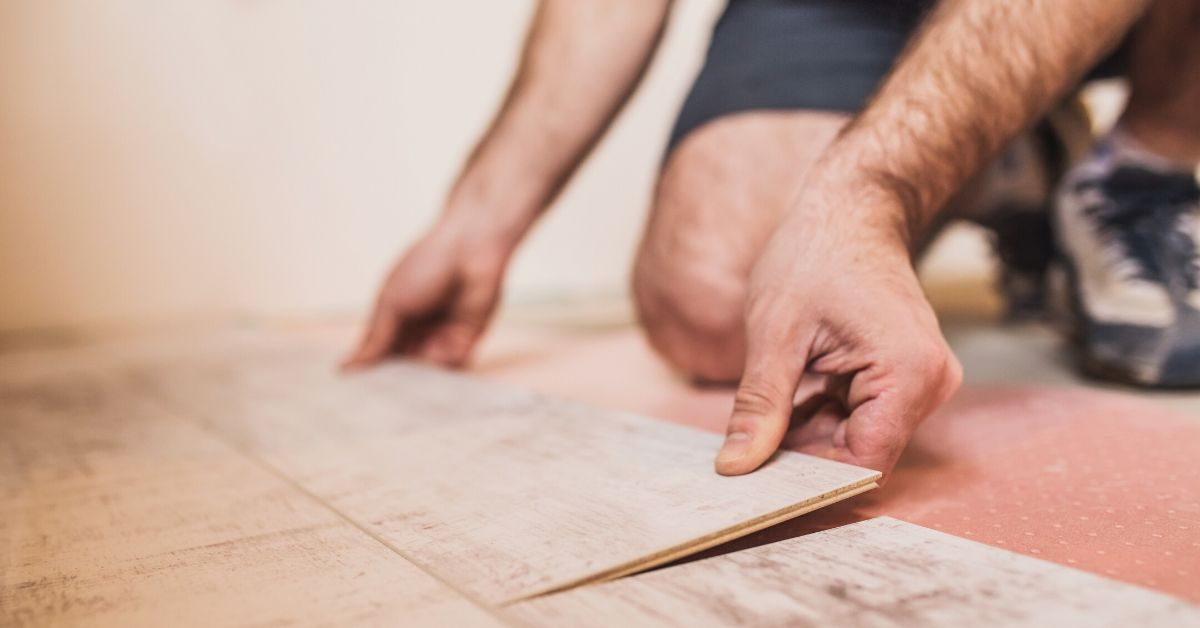 My Dream List of Home Upgrades - up close picture of man's hands putting together floor boards