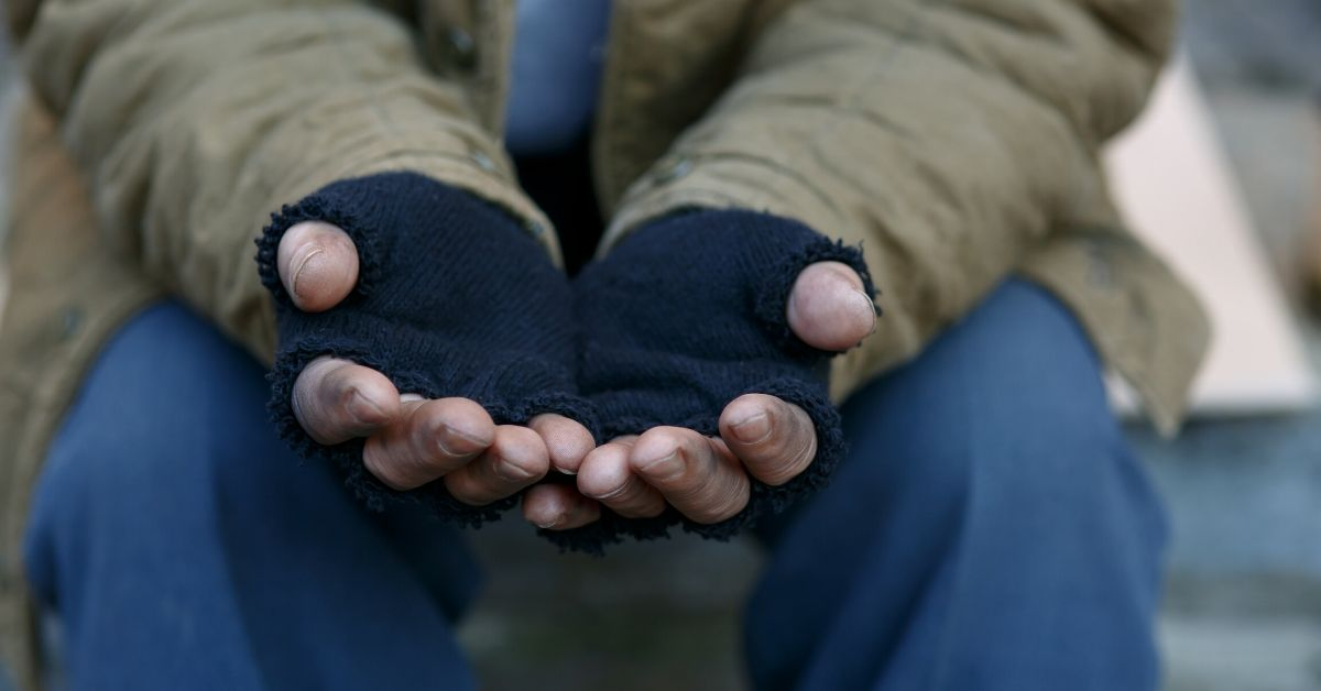 5 Reasons It's Okay to Give Money to Homeless People - picture of hands in fingerless gloves being held out