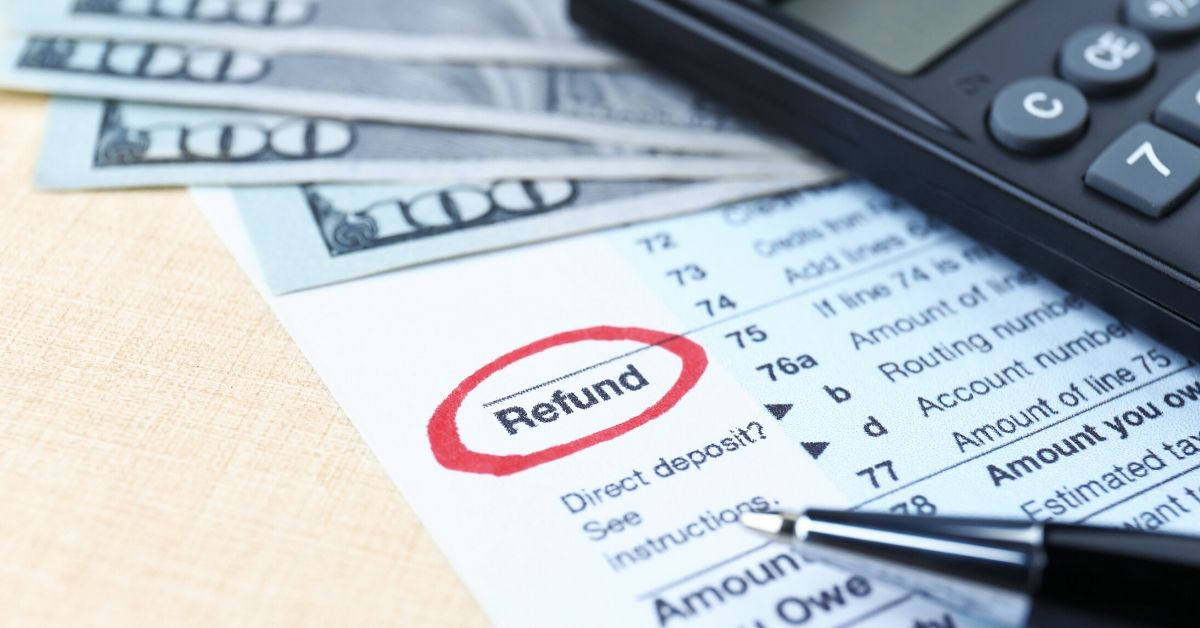 BeatTheDeadline - Get Your Taxes Done STAT - picture of tax return, cash, calculator, and pen