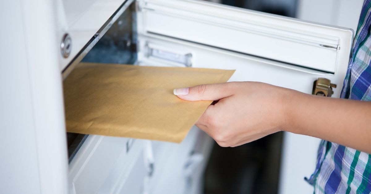 Horrific Financial Advice Right From My Mailbox - picture of hand pulling mail from mailbox