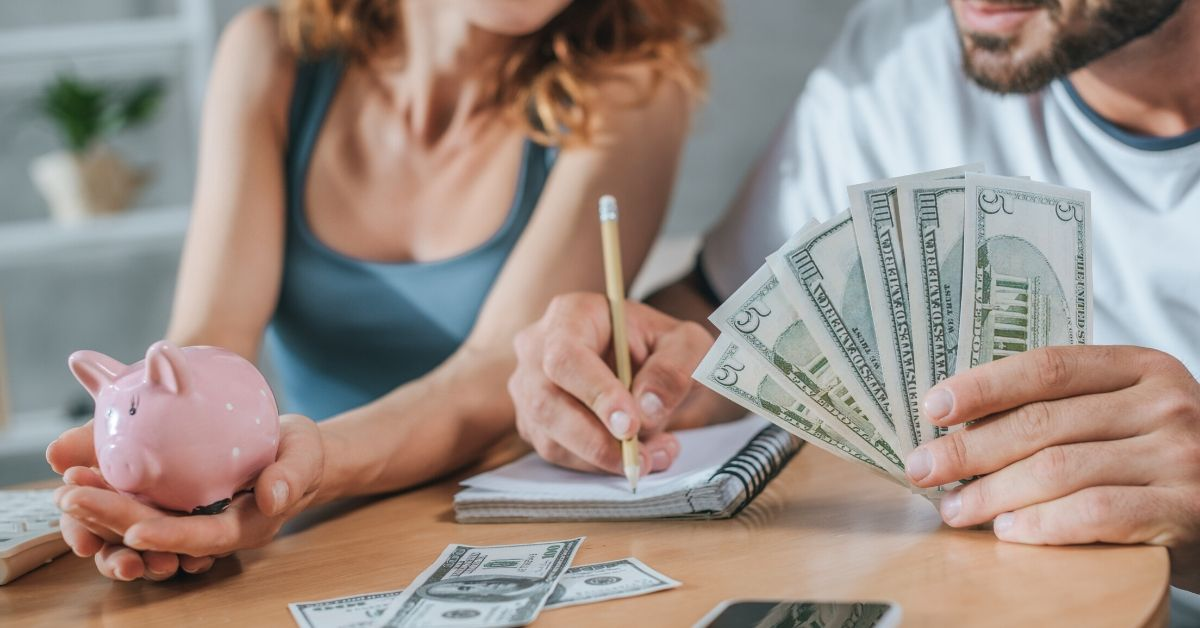 Negotiate Your Way to Savings - couple with cash and notebook