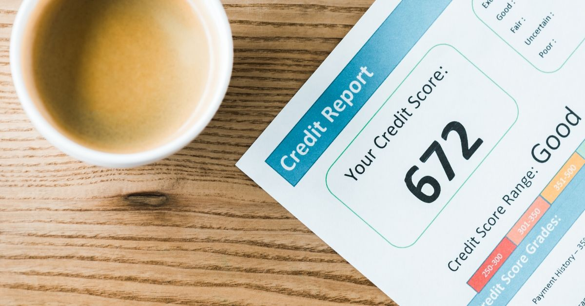 Rewards Travel and Your Credit Score - picture of credit report and cup of coffee