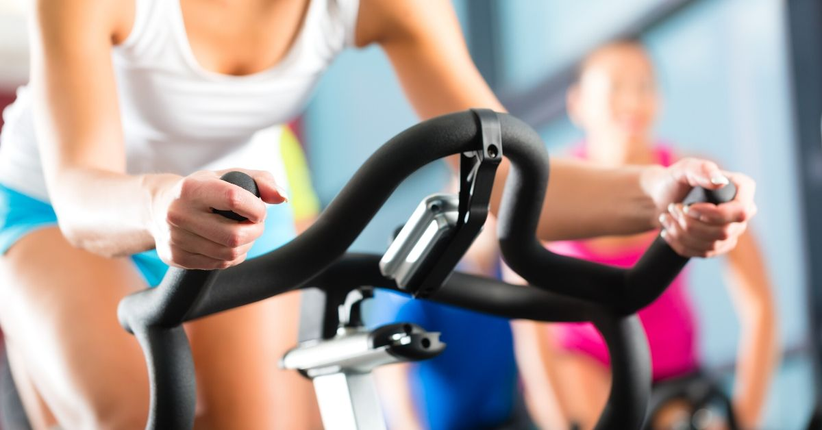 Unfortunate Ways I've Wasted Money - picture of women in spin class at gym