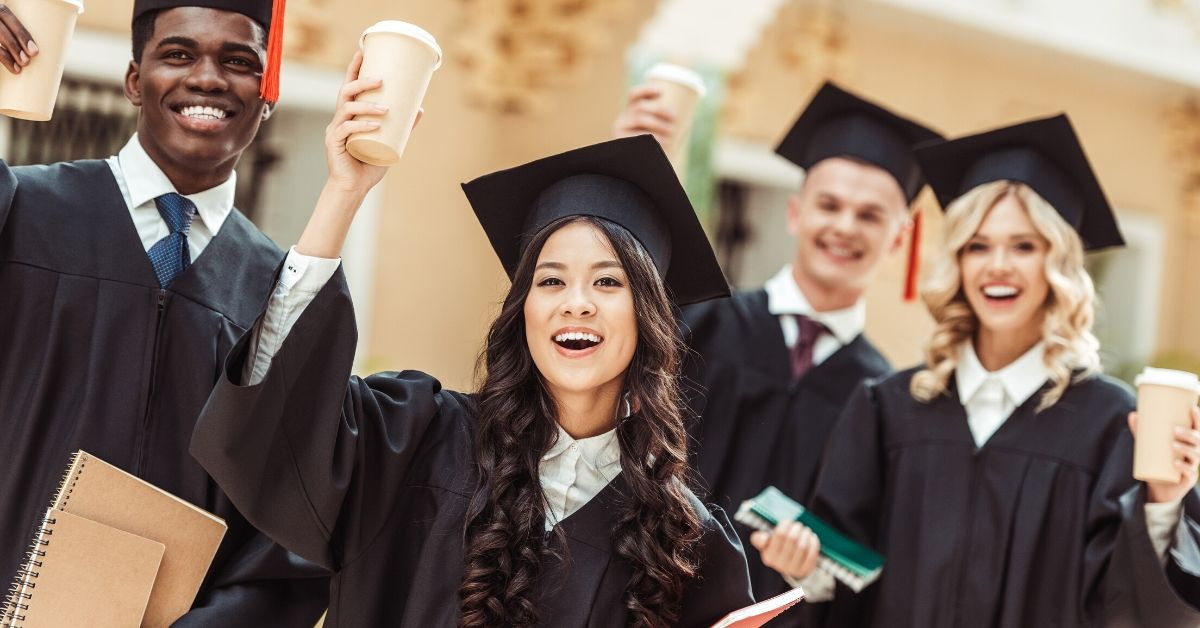 Top 3 Money Tips for Recent College Graduates - picture of graduates in cap and gown raising coffee cups