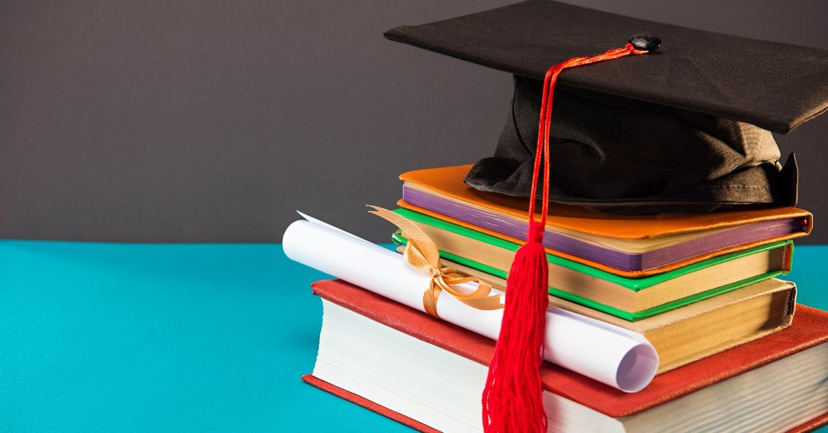 Why Giving Kids 4K for Christmas-picture of graduation hat and diploma on books