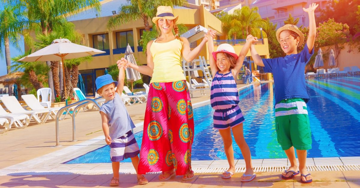 Disney Hotels Let Your Family Stay Free - picture of mom and 3 kids at pool